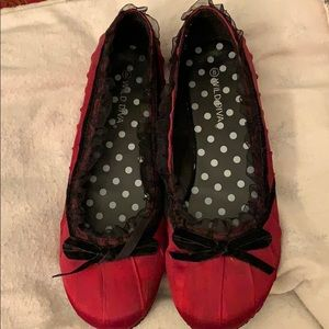 Red satin flats with ruffle and bow detail